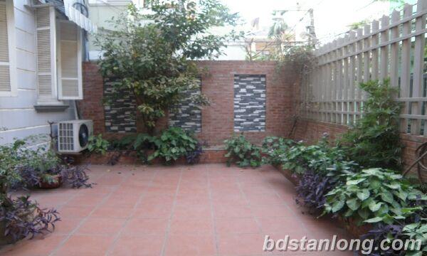 House with large yard in Nghi Tam street, Tay Ho for rent.